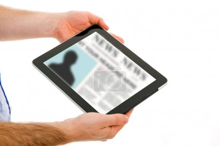 Image of man hands holding a touchpad computer and reading the n