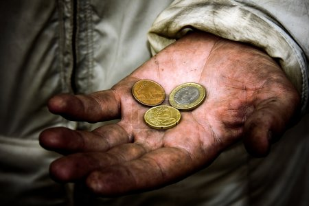Photo for A beggar with some coins on his dirty hands - Royalty Free Image
