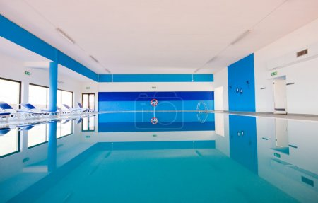 Photo for Luxury indoor swimming pool with beautiful clean blue water. - Royalty Free Image