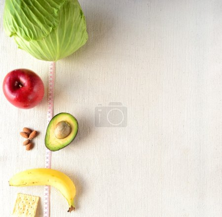 Healthy food with tape measure