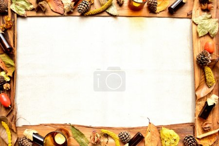 Frame of autumn leaves and aromatherapy supplies