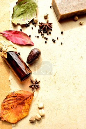 Autumn leaves and aromatherapy supplies
