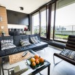 Modern apartment interior design with panoramic wi...