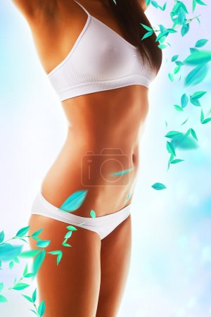 Beautiful woman body with white clothes and leaves