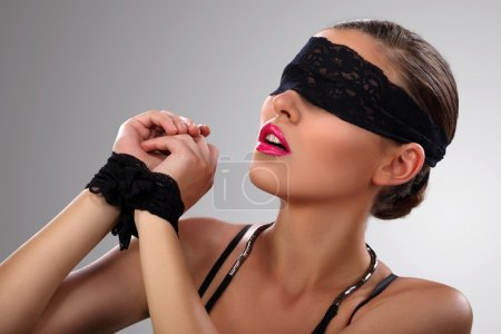 Attractive blindfolded girl close up