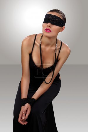 Blindfolded attractive girl sitting