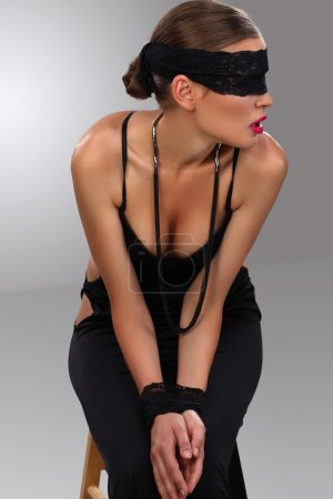 Blindfolded attractive girl posing