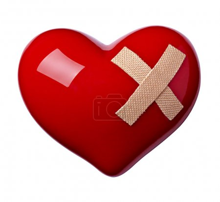 Photo for Close up of a heart shape with bandage on white background - Royalty Free Image