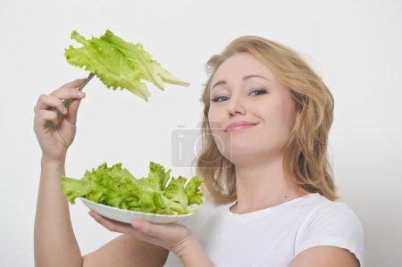 Girl and salad leafs