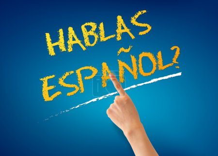 Photo for Finger pointing at a Hablas Espanol illustration on blue background. - Royalty Free Image