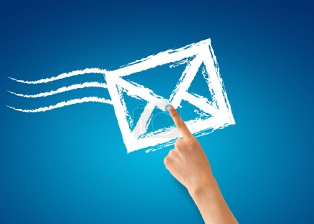 Photo for Hand pointing at a envelope on blue background. - Royalty Free Image