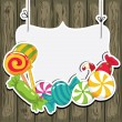 Sweets on strings on the wooden background. Vector...