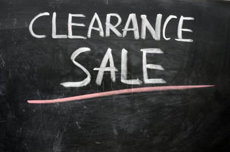 Clearance sale written on a blackboard