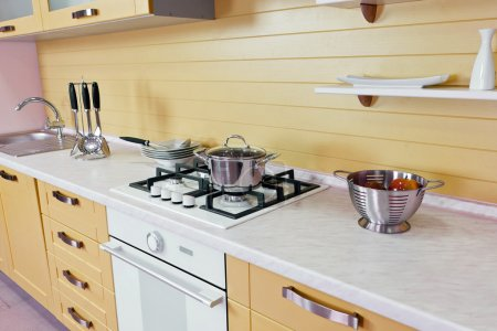Photo for Part of modern kitchen furniture of the yellow color executed from wood - Royalty Free Image