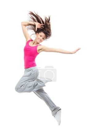 Photo pour Jeune danseuse moderne sautant et dansant hip-hop isolé sur fond blanc - image libre de droit