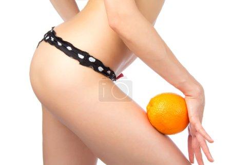 Weight loss concept Hip, legs, abdomen and orange