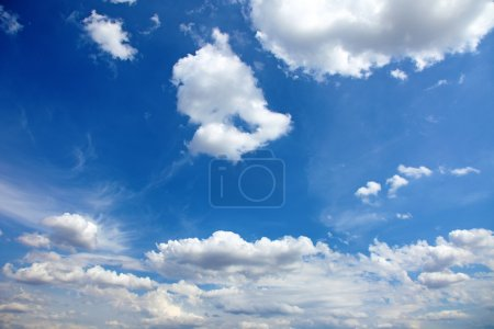 Beautiful blue summer sky with clouds as background or backdrop.