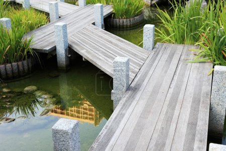 Photo for Wooden walkway in japanese garden in Monaco, Europe. - Royalty Free Image