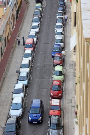 Small street of Nice city with lot od parked cars, France, Europ