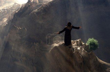 Photo pour Une silhouette de prêtre dans un paysage . - image libre de droit