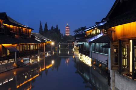 Night scene of traditional building near the river...