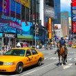 Police and taxi at a Times Square Intersection in ...