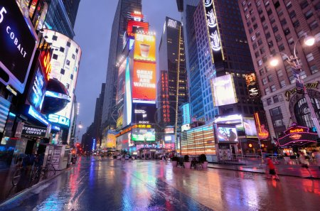 Photo for NEW YORK CITY - AUGUST 27: A wet Times Square August 27, 2011 in New York, NY. Times Square is the world's most visited tourist attraction bringing over 39 million tourists annually. - Royalty Free Image