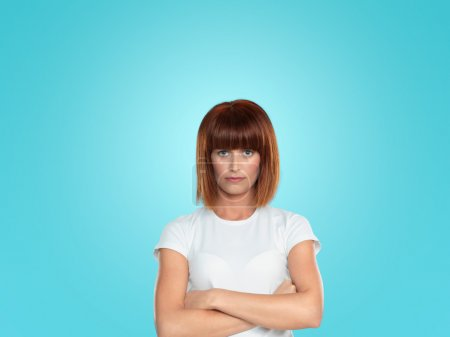 Attractive woman hostile attitude with arms crossed