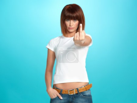 Photo for Beautiful, young woman showing the middle finger, on blue background - Royalty Free Image