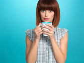 Pretty young woman drinking hot coffee