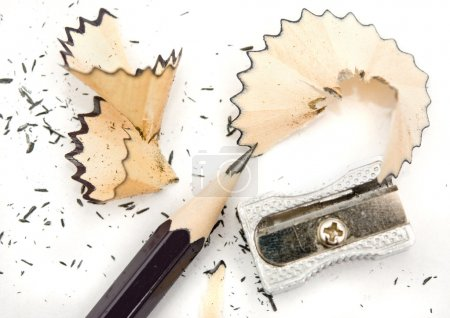 Pencil sharpener and a white background with...