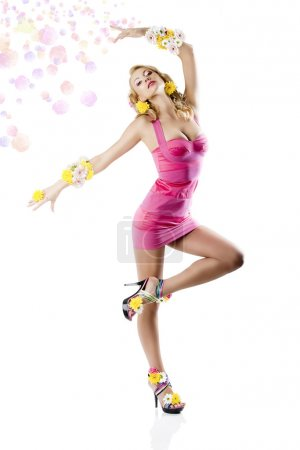 Flower fashion girl with pink dress in a ballet position
