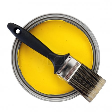 Photo for Yellow paint with paintbrush over white background - Royalty Free Image