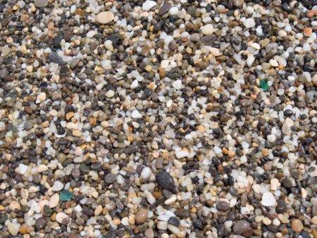 Photo pour Galets (sable panaché de grande taille) surface de la côte - image libre de droit