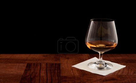 Glass of whiskey served on a bar top isolated on a...