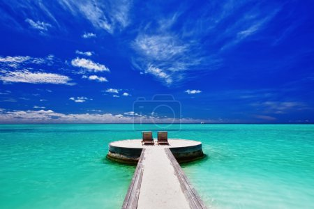 Two deck chairs on stunning tropical beach