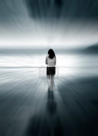 Photo for Girl Walking into blurry light - Royalty Free Image
