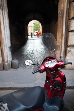 Scooter parked in one of the ancient streets of Rome
