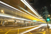Urban landscape with busy traffic in Hong Kong at night
