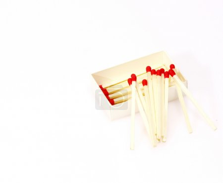 Red matches isolated on white background