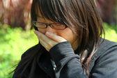 Asijské ženy kýchání
