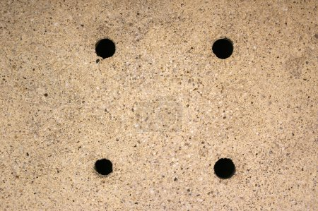 Four holes on the ground background