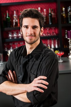 Photo for Portrait of handsome barman standing in front of the bar - Royalty Free Image