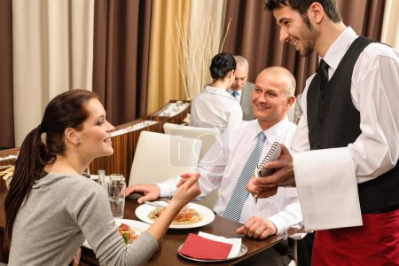 Photo for Business served by waiter enjoy lunch at the restaurant - Royalty Free Image
