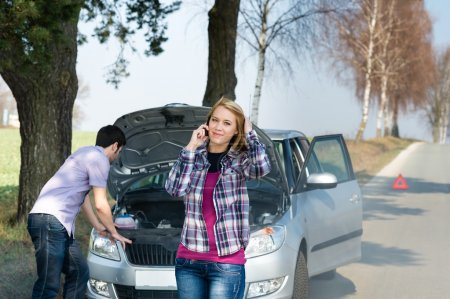 Photo for Car breakdown couple calling for road assistance man look engine - Royalty Free Image