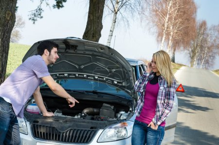 Photo for Car breakdown couple calling for road assistance man point engine - Royalty Free Image