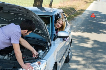 Car troubles couple starting cables vehicle