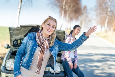 Photo for Car failure two young women waiting for help road assistance - Royalty Free Image