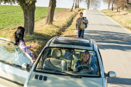 Hitch-hiking parked car girl friends offer lift