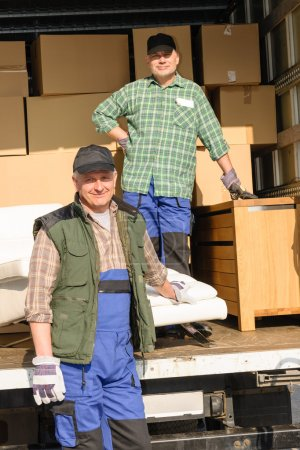 Mover two man loading furniture and boxes